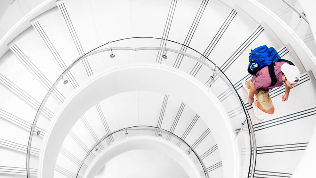 one student on white spiral staircase